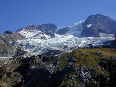 Tahoma Glacier descending from the rocky summit of Mount Rainier.