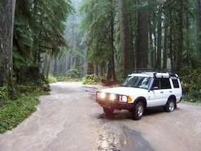 A vehicle caught in the Carbon River as it washes across the Carbon River Road during the November 2006 flood.