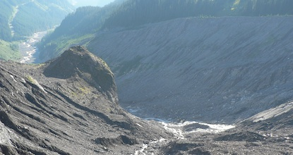 Rock and sediment moraine field left behind by the Nisqually glacier, with the Nisqually river carrying materials downstream.
