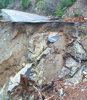 Broken roadway and landslide debris