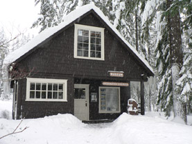 The Longmire Museum covered in snow.