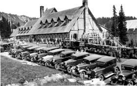 The historic Paradise Inn with old fashioned cars parked in front.