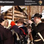 Cover of the new Junior Ranger Booklet with Re-enactors at the Huts in Jockey Hollow during the winter