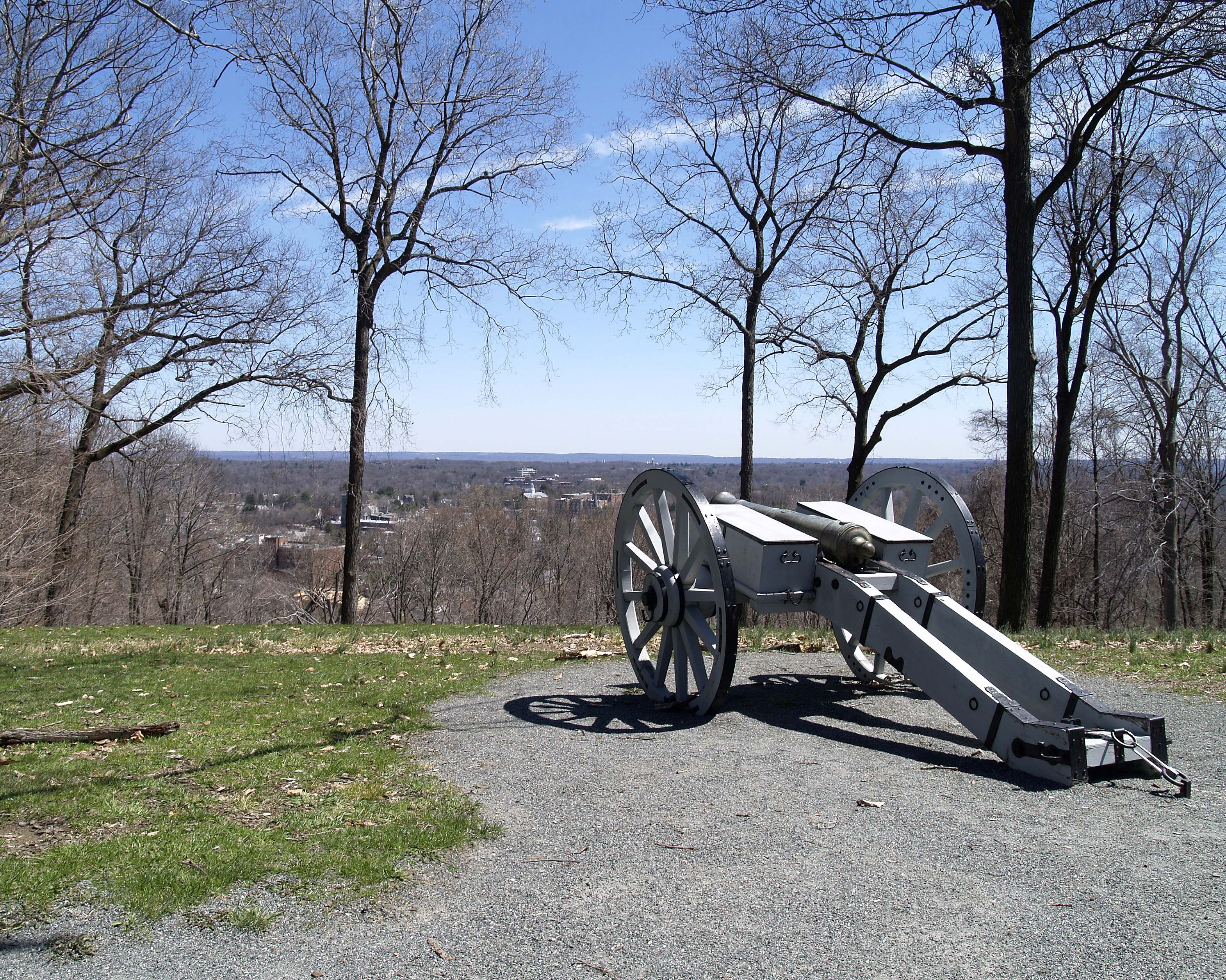 Photo of the Cannon at Fort Nonsense with view of Morristown in the distance