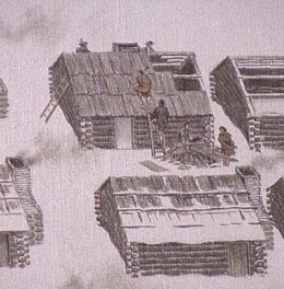 Soldiers building huts with deep snow on the ground.