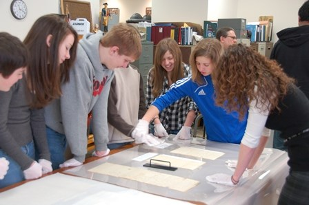 Students looking at primary source documents.