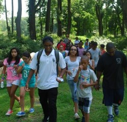 Youth Conservation Corps member leading middle school students on a hike in Jockey Hollow.