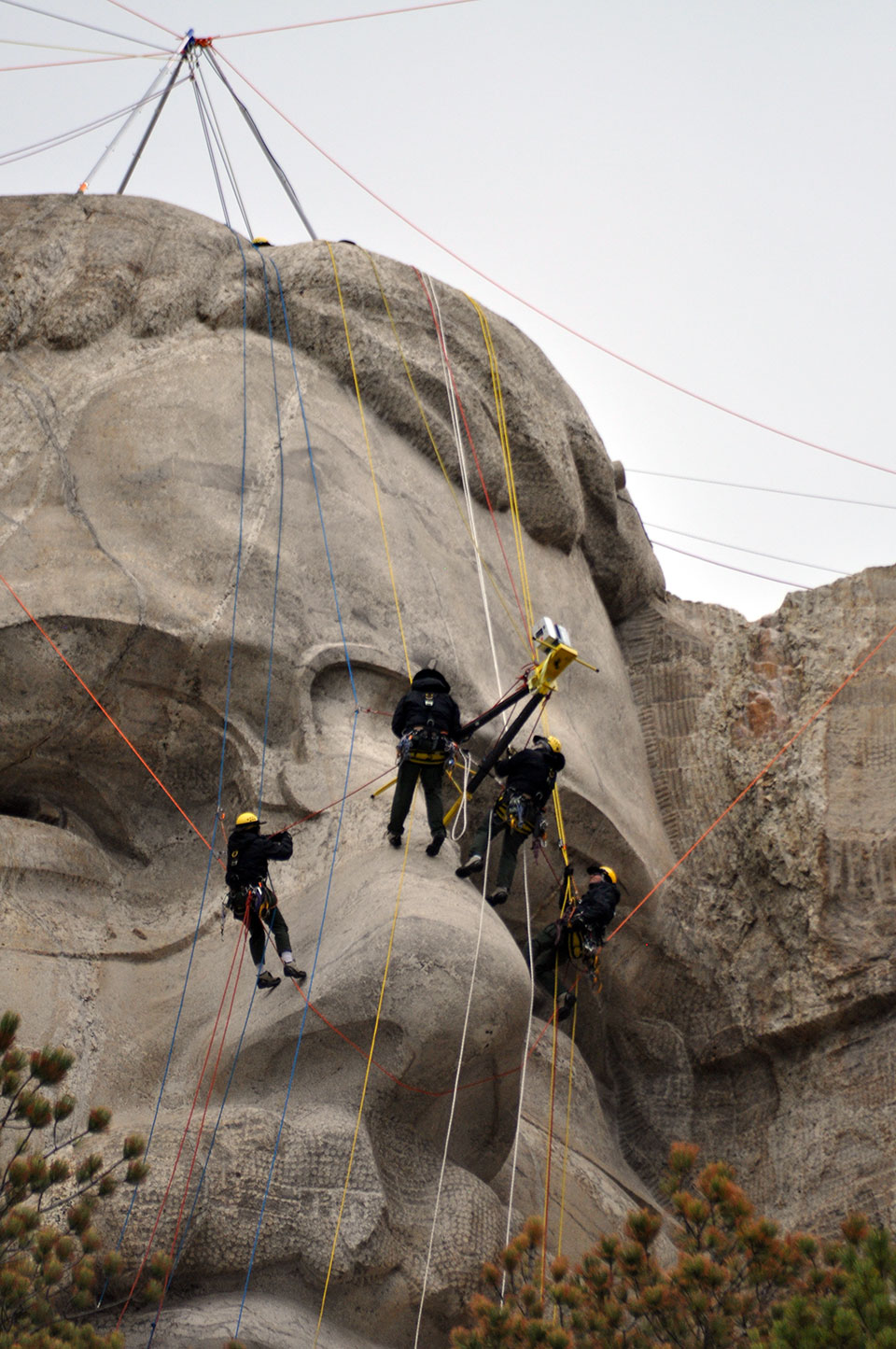 Mount Rushmore's rope access team scans Theodore Roosevelt.