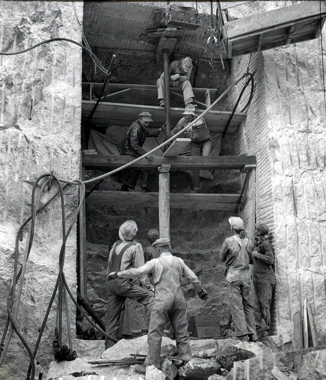 Workers in the early stages of constructing the Hall of Records.
