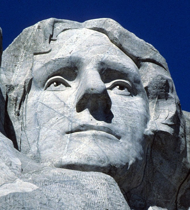 Photo of Thomas Jefferson on Mount Rushmore.