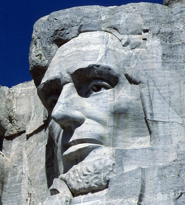 Photo of Abraham Lincoln on Mount Rushmore.