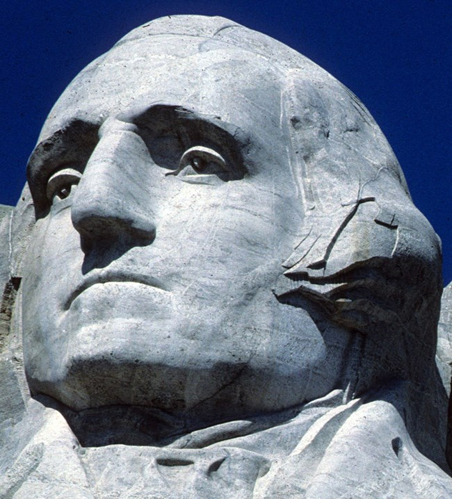 Photo of George Washington on Mount Rushmore.