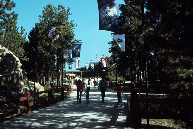 Walkway from the parking lot to the Visitor Center as it looked after the state flags were added for the Bicentennial Celebration in 1976.