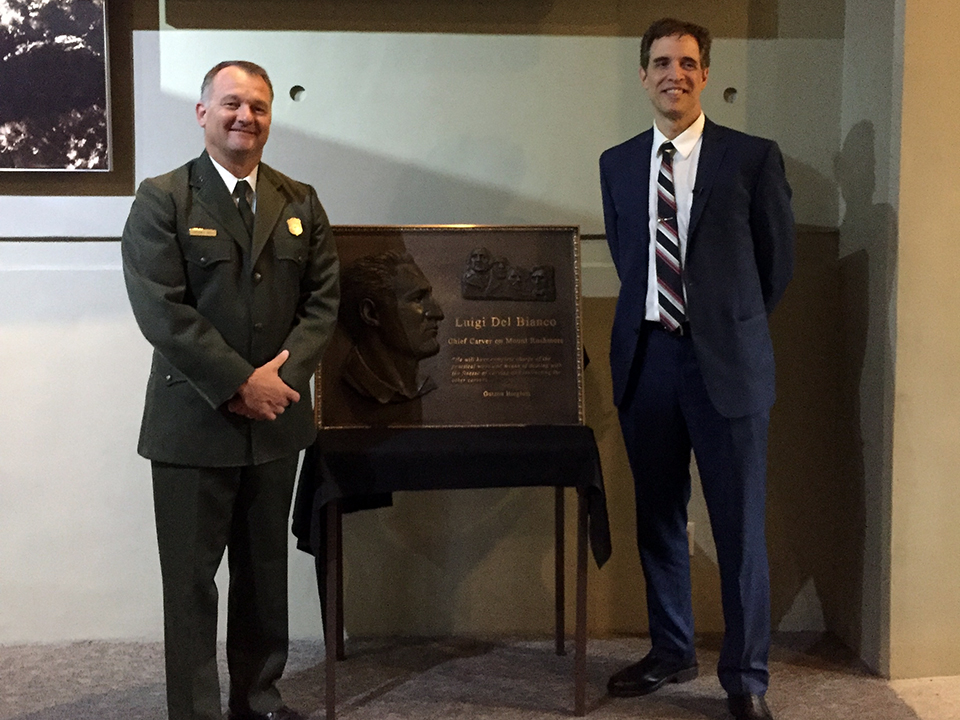 Cam Sholly, National Park Service Regional Director, and Lou Del Bianco, Grandson of Luigi Del Bianco, with new plaque honoring the Chief Carver.