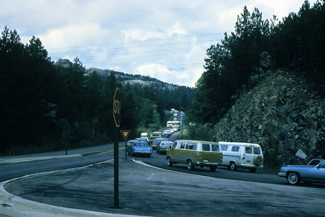 Vehicles sometimes backed up nearly three miles before the construction of the parking garage during the 1990's.