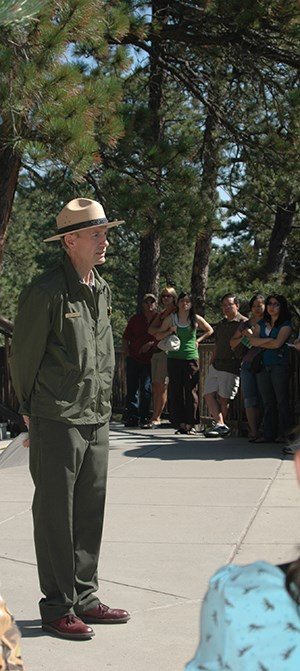 A park ranger presenting a ranger talk along the Presidential Trail.