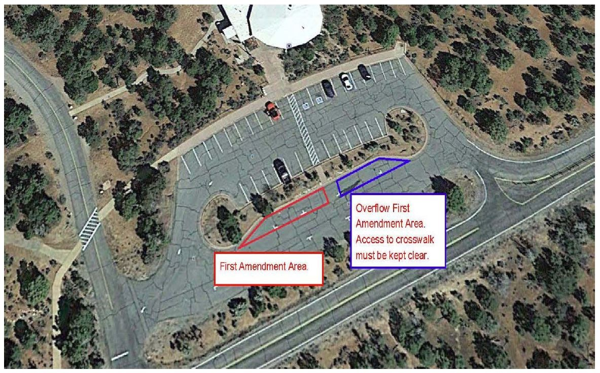 An overhead view of a visitor center and parking lot with the First Amendment area marked
