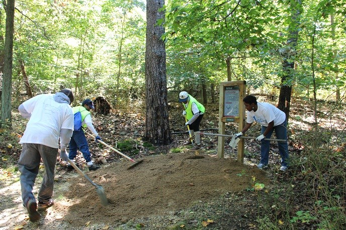 a group of volunteers improving one of our many trails