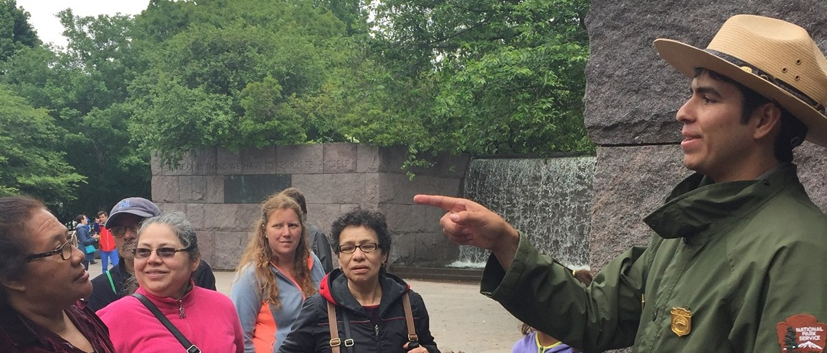 Ranger talks with a group of visitors at Franklin Delano Roosevelt Memorial.