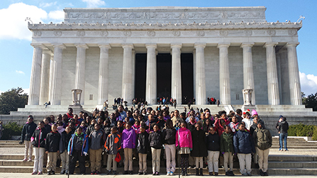 children gather on the steps of the lincoln memorial