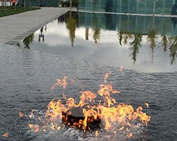 Flame in reflecting pool
