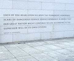 etched words in a grey-white granite wall