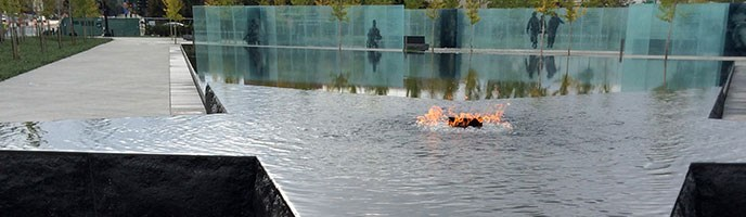 memorial flame, star pool, glass panels and trees