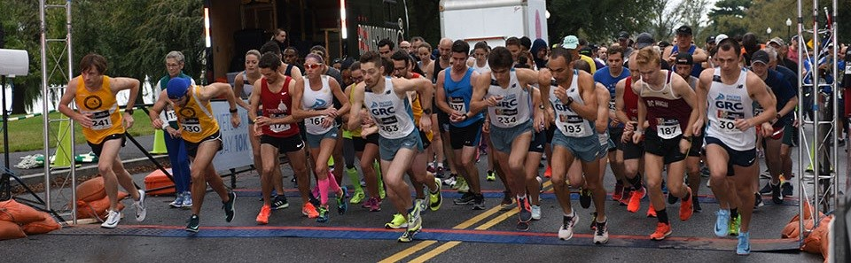 Group of runners at a race start line