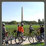 Visitors biking in front of Washington Monument