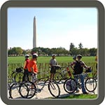 A ranger led bike tour in front of the washington monument