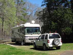 A RV and car in the Volunteers campsite at Mount Locust.