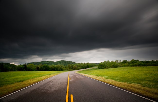 Dark clouds above  the Natchez Trace Parkway road way