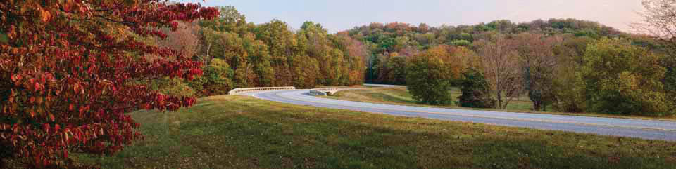 A curve along the Natchez Trace Parkway with fall colors