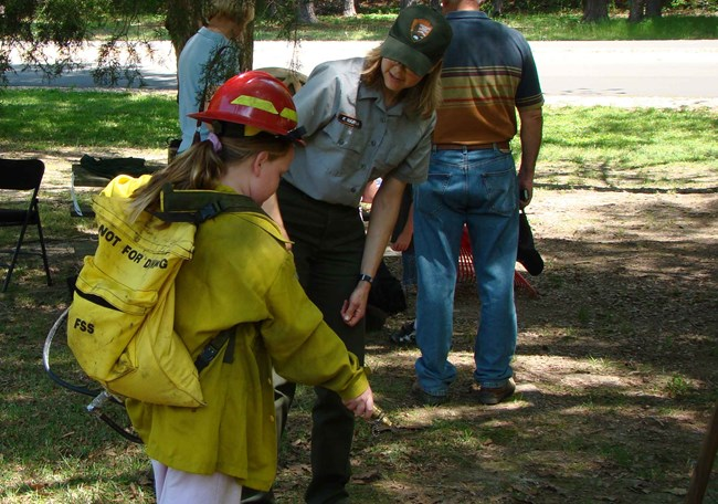 A Junior Ranger wears the fire gear during a special program.