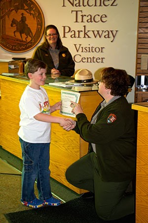 Junior Chief Ranger Steven Wilbanks receives his certificate from Chief of Interpretation Terry Wildy.