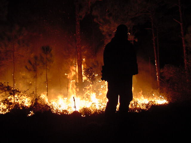 Firefighter watching for embers.