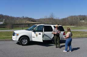A Park Ranger helps answer visitor questions while traveling on the Natchez Trace Parkway.
