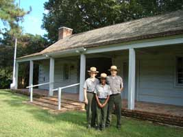 Three Park Rangers at the Ridgeland Information Cabin.