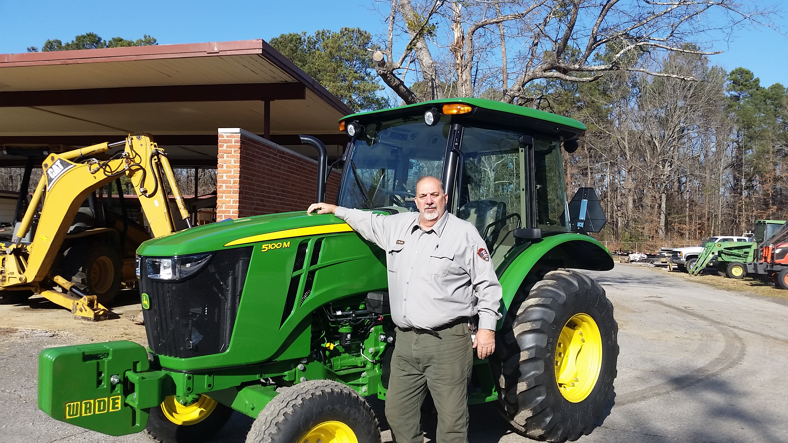 Michael Phillips stands by one of the many tractor's he operated and maintained at the Parkway.