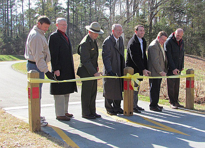 6 park partners join superintendent Sholly for the multi-use trail ribbon cutting