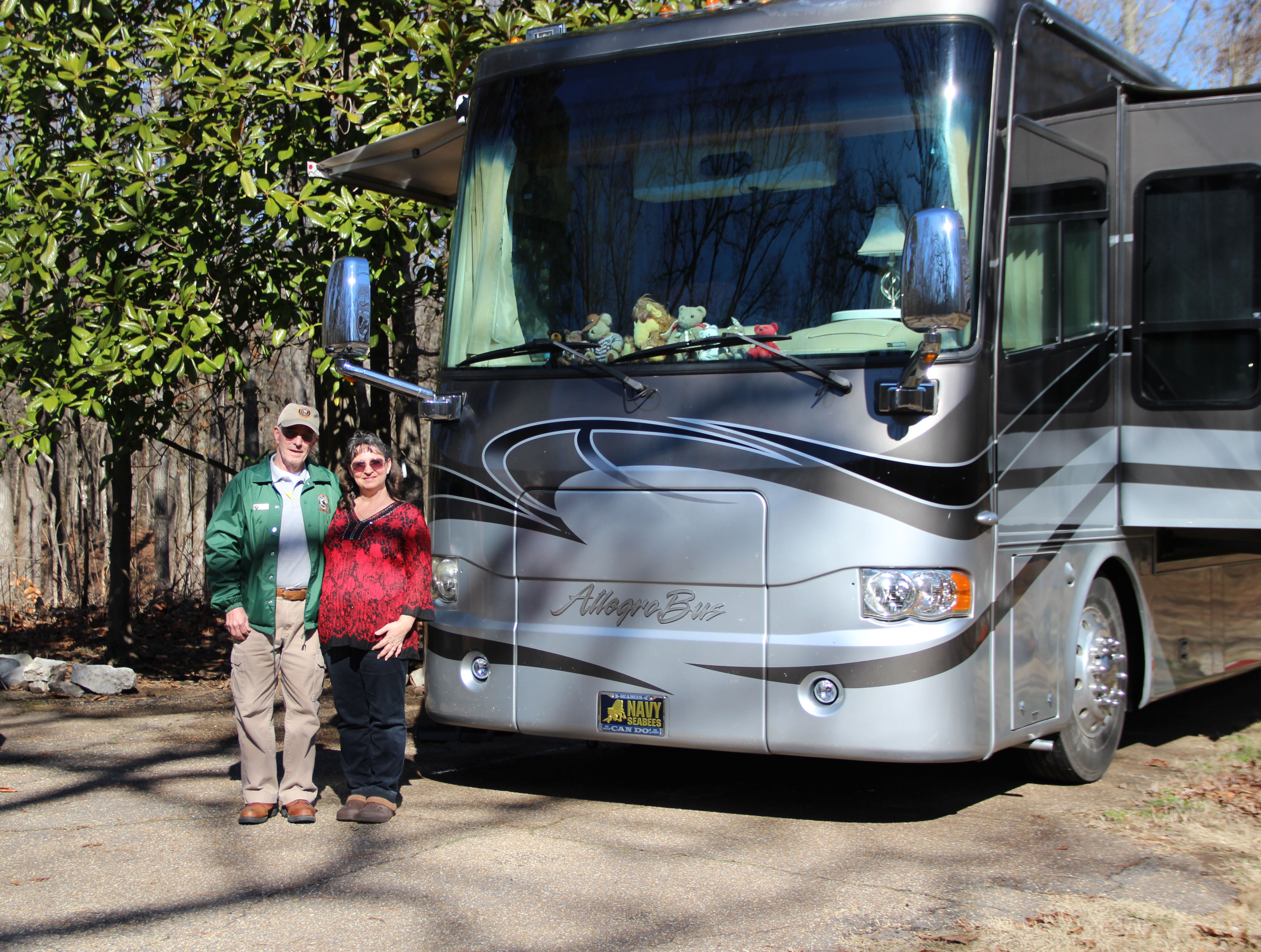 volunteer Denny Sims and his wife Lisa standing in front of a recreational vehicle