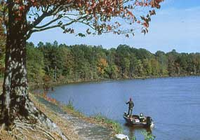A fisherman in a boat along the Natchez Trace Parkway