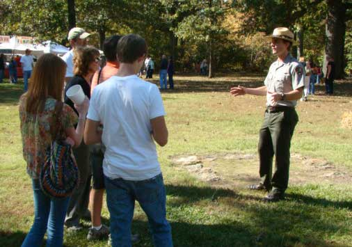 Visitors join a ranger for a scheduled talk.