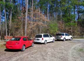 Vehicles at the Highway 7 Trailhead parking area.