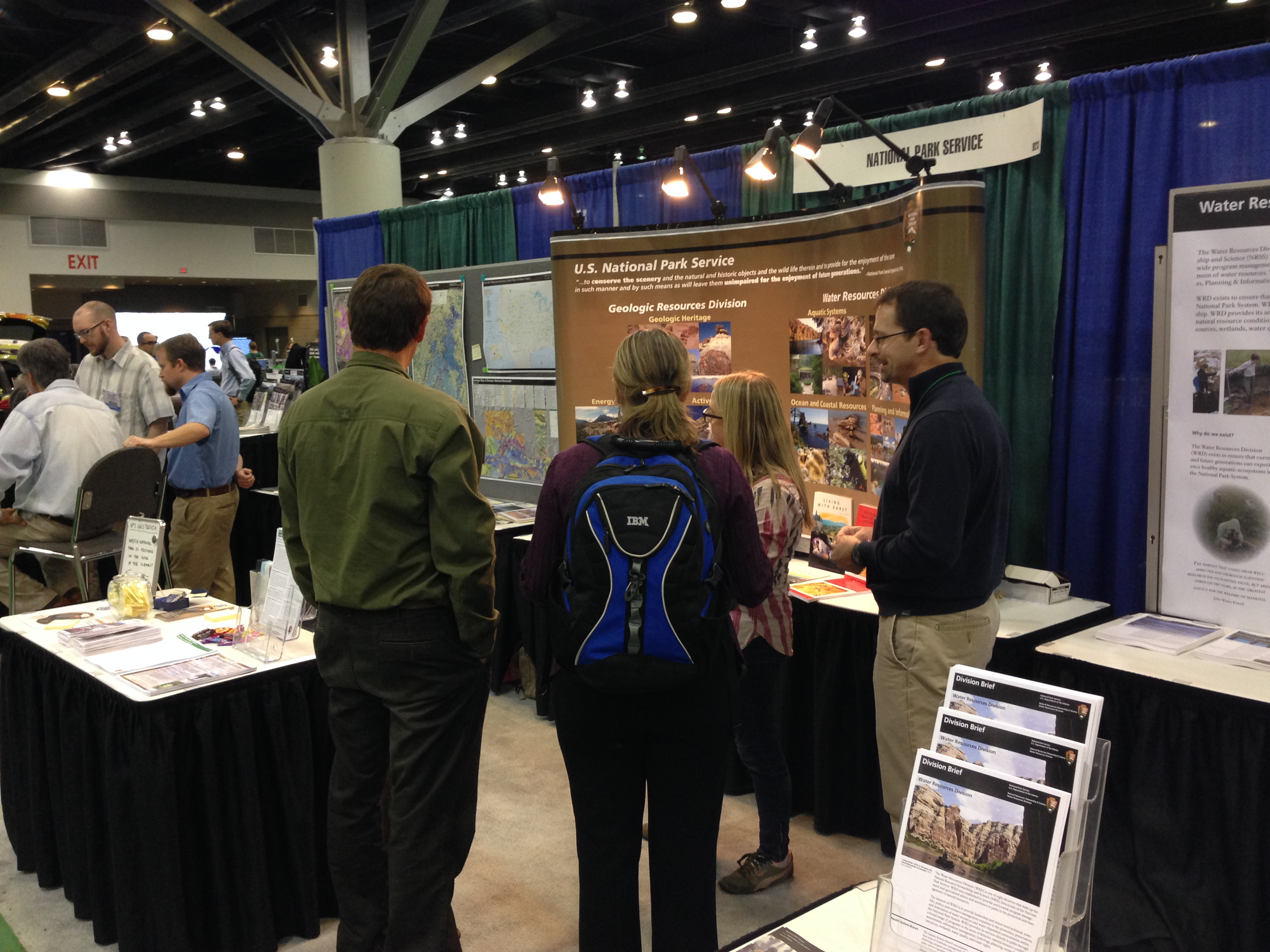 Conference attendees visit the NPS booth at the GSA conference in 2015