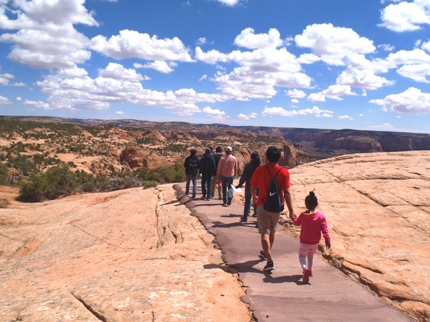 Visitors walk on the paved Sandal Trail to the Betatakin Overlook.