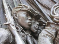 A close up of the Shaw Memorial in Boston, sculpted by Augustus Saint Gaudens.