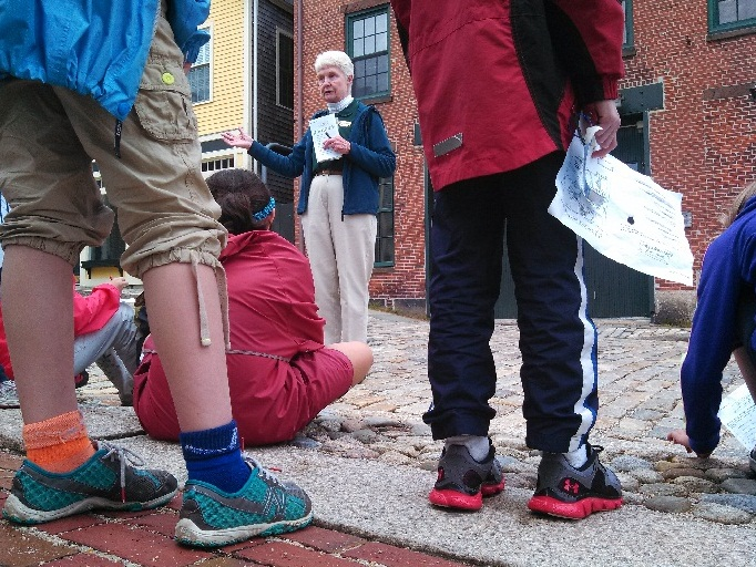 Park volunteer leads a group of third graders on a walking tour of downtown New Bedford.