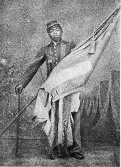 William Carney holds the American flag while in Union Army colors.