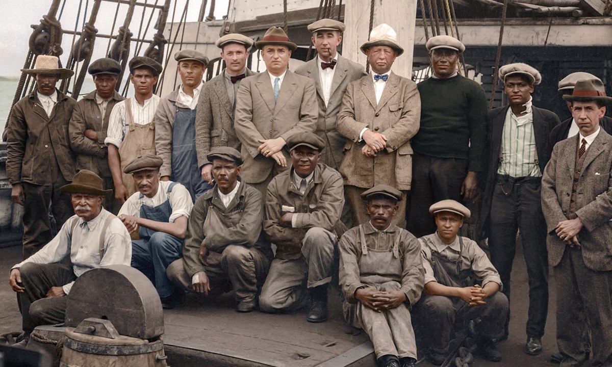 Whaling crew pose aboard ship.